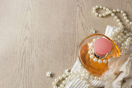 Elegance  Perfume Bottle with white pearls photo