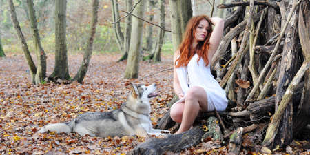 young woman with her dog in autumn