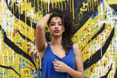 sexy girl dance: young woman in front of a street art wall Stock Photo