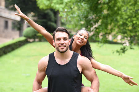 young couple doing sports in a park