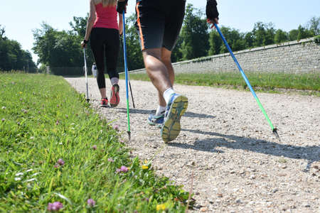 Young couple practicing nordic walking