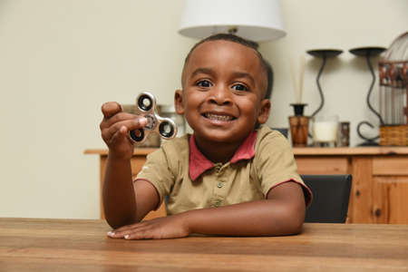 Young boy playing hand spinner