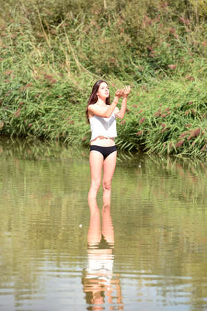 young woman bathing in nature
