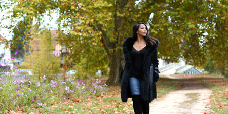 young asian woman in autumn nature