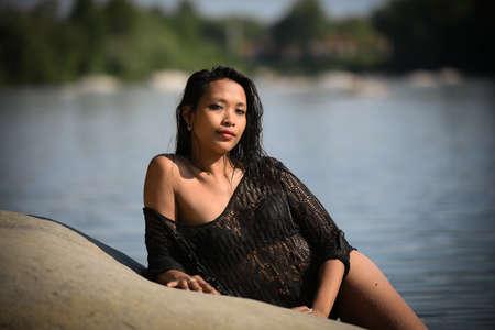 lovely asian woman bathing in a lake