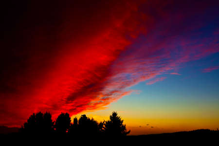 gild: Violent clouds flow across the sky and gild the sunset