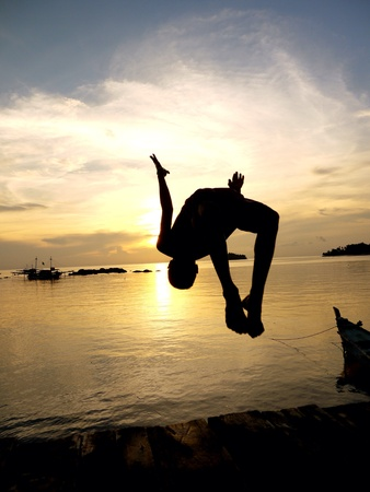 Jumping kid with silhouette background in Belitung Island. It seems there was no economic pressures in this kids mind. I wish i could have that kind of thought as well