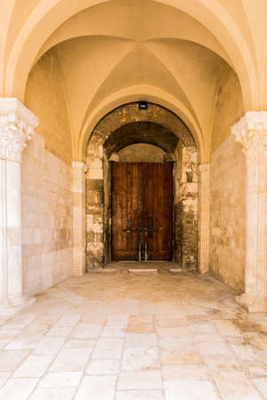 Archway entrance of Svevo castle in Italy