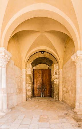 Archway entrance of Svevo castle in Italy