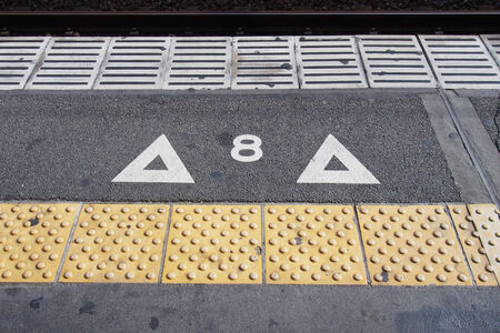 indicative: Indicative signage on the floor in Japanese train station