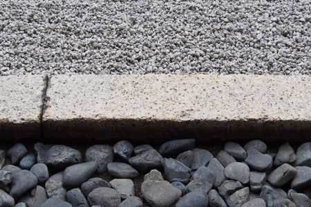 seperation: Stone curb divider between rock and gravel Stock Photo