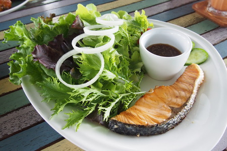 Salmon  steak with fresh salad photo