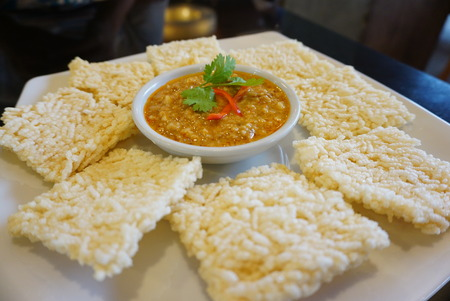 thai style: crispy rice crust with Thai style dipping sauce