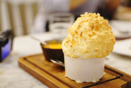 thai style: Thai style crab meat curry with Souffle on the block Stock Photo
