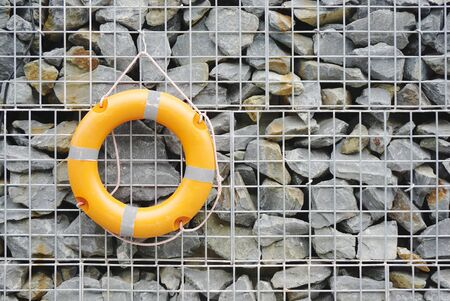 life preserver: life preserver on the rock wall