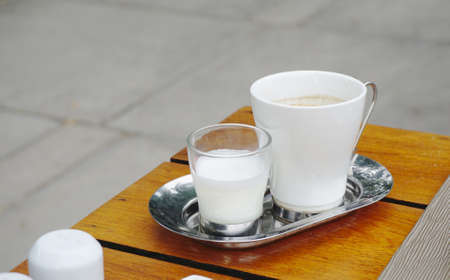 steel  milk: Coffee with milk on stainless steel plate Stock Photo
