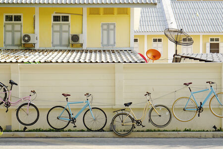 casters: Bicycle wall with building background