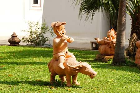decorative item: Clay statue in kid and buffalo shape garden decorative item