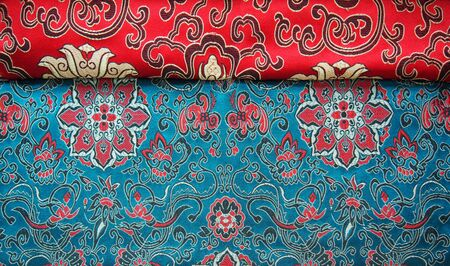 shinny: red and blue shinny fabric texture with asian pattern