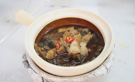 belly pepper: streaky pork with viggie soup Singapore style Stock Photo