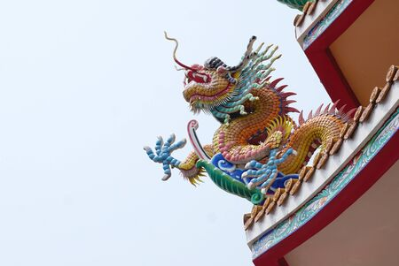 ceramic tile: Colorful Chinese dragon sculpture decoration with small ceramic tile in Chinese temple in Thailand Stock Photo