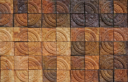 natureal: Wall elevation detail of the circle shape decorative orange tone color  terracotta tiles texture with diffence tone color Stock Photo