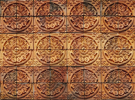 elevation: Wall elevation detail of the circle shape decorative orange tone color clay tile texture with diffence tone color