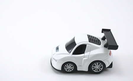 diminutive: Isolated image of the white color toy car with black wheels