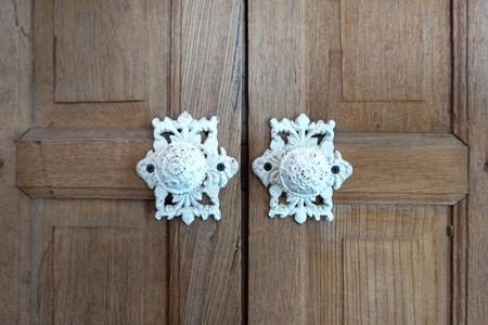 door knobs: Elevation of the Vintage white paint furniture door knobs on rustic timber door