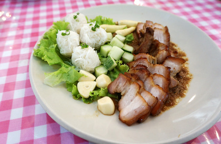 Vietnamese dish of roast belly pork with speacial sauce serving with white Vermicelli and fresh vegetable