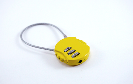 number lock: isolated of small yellow baggage numaric lock with 911 number on it Stock Photo
