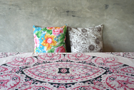 throw cushion: local pattern table sheet fabric with colorful throw cushion and concrete wall background