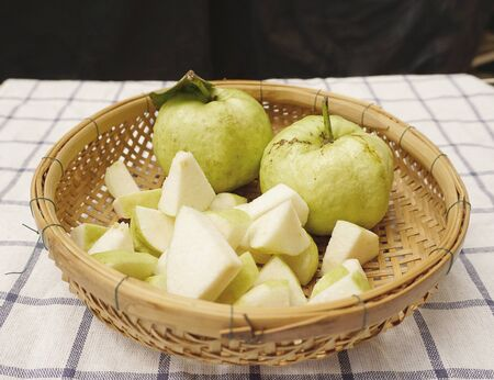 checker board: fresh guava fruit on the basket with checker board background Stock Photo