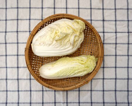 checker board: white cabbage on woven basket with checker board background