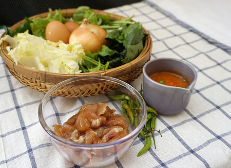 checker board: closed up of Food ingredients for Thai style vegetable soup with chicken on the checker board fabric