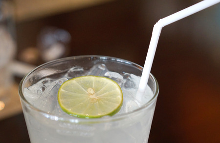 closed up: closed up of lemonade drink with lemon slide on top and white straw Stock Photo