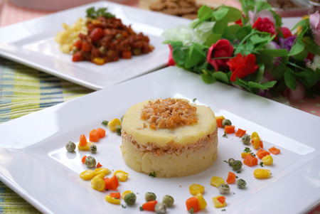 suger: closed up of the beautiful speical dog food made from salmon fish  potato mash  corn  carrot and suger peas serve on white plate