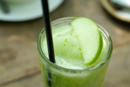 potation: closed up od apple frappe drinks with apple slide on top Stock Photo