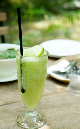 potation: Apple frappe drinks with apple slide on top with nature background Stock Photo