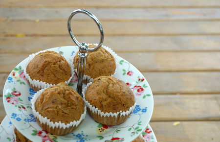 closed up: closed up of the banana cupcakes on white plate with timber background Stock Photo