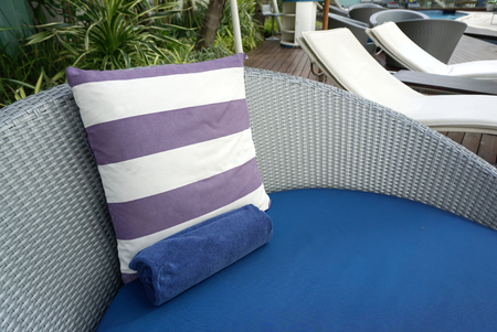 white backing: purple and white stripe cushion on blue beach bed with grey plastic woven backing