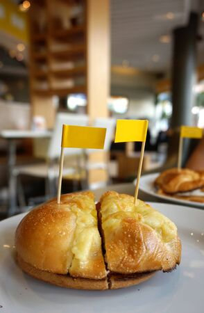 closed up: closed up of Bagel with egg and katch up with small yellow flags