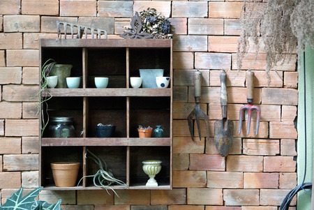shelving: Gardener tools timber shelving mount on the brick wall with hanging garden tools