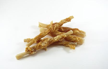 dog bone: Dog snack made from Chicken wrap on dog bone with white background