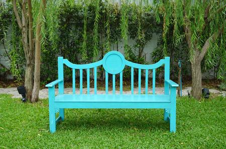 garden bench: Turqouise color garden bench on green grass Stock Photo