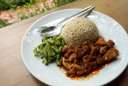 long bean: brown rice , long bean and  spicy chili paste pork with nature background Stock Photo