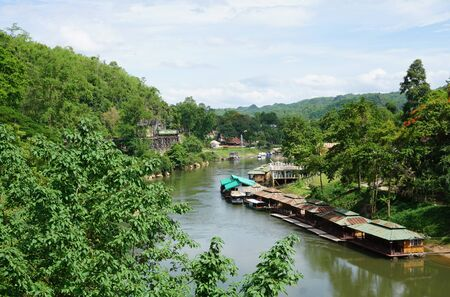 house float on water: Floating house in the river with railway and nature in Kranchanaburi province, Thailand