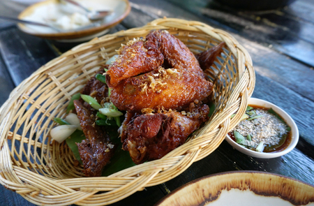 deep fried: Deep fried chicken wing with garlic in the basket