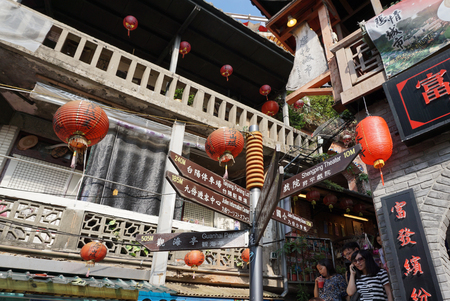 jiufen: Direction signage with traditional red lantern in old town Jiufen, Taiwan in August 2015