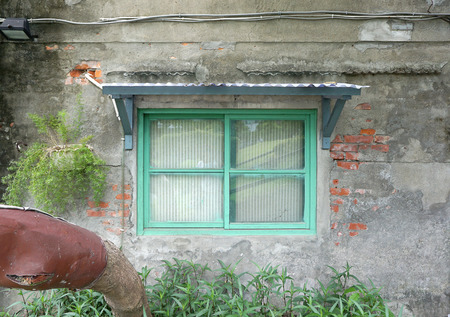 plant pot: Green window frame with rustic building wall and hanging plant pot